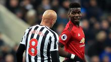 Paul Pogba, right, suffered a knock following a challenge by Newcastle midfielder Jonjo Shelvey (Owen Humphreys/PA)