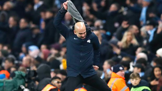 Manchester City manager Pep Guardiola throws his scarf in anger during a tense clash (Martin Rickett/PA)
