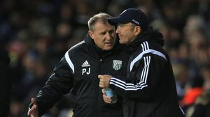 Paul Jewell, left, has placed the circumstances around his exit from West Brom in the hands of his lawyer