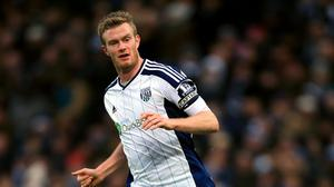 Chris Brunt, pictured, has been banned for one game and fined £8,000 by the Football Association
