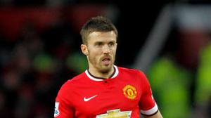 Manchester United's Michael Carrick insists he will not be 'satisfied with third'