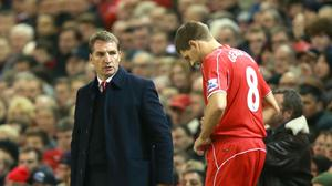 Brendan Rodgers, left, felt bad for leaving Steven Gerrard, right, out of his side on the 16th anniversary of his Liverpool debut