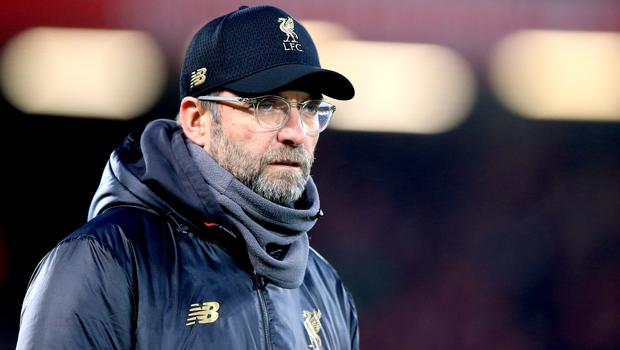 Jurgen Klopp expects the title race to go to the wire (Peter Byrne/PA)