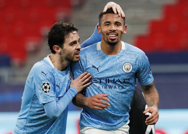 Manchester City's Gabriel Jesus celebrates with Bernardo Silva after scoring their second goal . Photo: Reuters