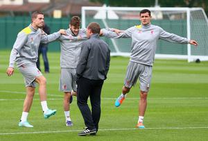 Liverpool manager Brendan Rodgers has a word with L-R Jordan Henderson, Adam Lallana and Dejan Lovren during a training session ahead of their UEFA Champions League group B match against PFC Ludogorets