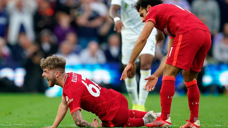 Liverpool's Harvey Elliott calls out in pain as team-mate Mohamed Salah checks on his condition after picking up a bad injury following a challenge by Leeds United's Pascal Struijk. Photo: PA Wire