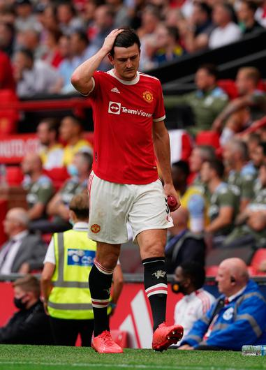 Manchester United's Harry Maguire leaves the pitch after suffering an injury against Aston Villa. Photo: PA Wire