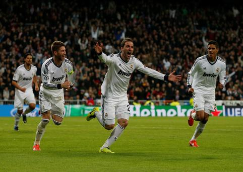 Real Madrid's Gonzalo Higuain (C) celebrates his goal against Galatasaray with captain Sergio Ramos