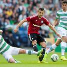 Callum McGregor, Celtic (left) and Tomasz Jodlowiec, Legia Warsaw (right) during the Champions League Qualifying at Murrayfield, Edinburgh
