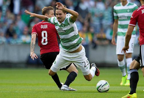 Celtic's Mikael Lustig (right) and Legia Warsaw's Ondrej Duda (left) during the Champions League Qualifying match at Murrayfield, Edinburgh