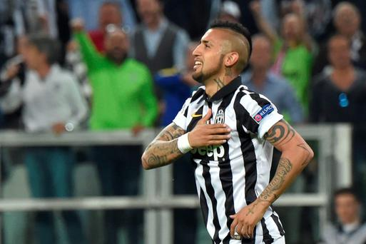 Juventus' midfielder from Chile Arturo Vidal celebrates after scoring a penalty against Monaco