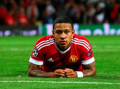 Memphis Depay reacts after missing a chance for his hat-trick during an impressive display at Old Trafford
