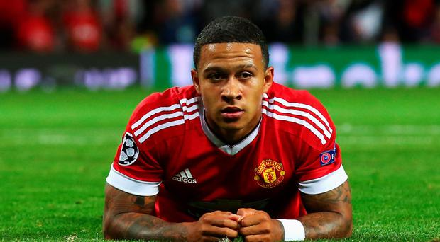 Memphis Depay reacts after missing a chance