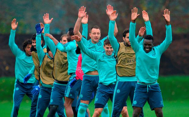 John Terry (centre) goes through a training drill at Cobham ahead of tonight's Champions League clash with Dynamo Kiev