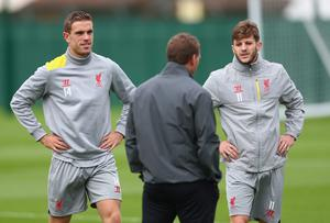 Liverpool manager Brendan Rodgers has a word with L-R Jordan Henderson and Adam Lallana during a training session ahead of their UEFA Champions League group B match against PFC Ludogorets