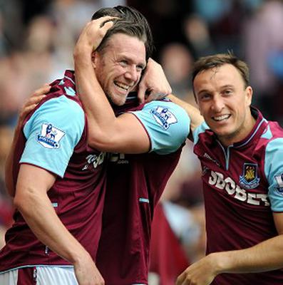 Kevin Nolan, left, was mobbed by team-mates after breaking the deadlock