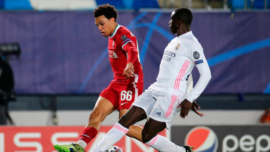 Real Madrid's Jose Vinicius Junior (right) is fouled by Liverpool's Trent Alexander-Arnold