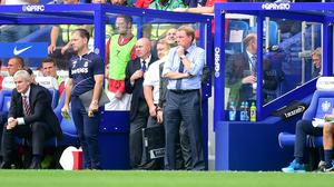 Harry Redknapp, centre, watched QPR fight back to draw 2-2 against Stoke