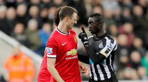 Jonny Evans, left, and Papiss Cisse, right, will serve lengthy suspensions for spitting at each other
