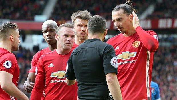 Manchester United striker Zlatan Ibrahimovic, right, appeals to referee Kevin Friend
