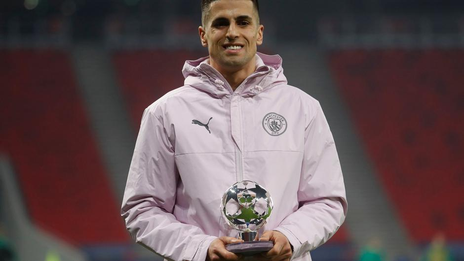 Joao Cancelo holds the player of the match trophy after the Champions League round of 16 first leg between Borussia Monchengladbach and Manchester City at the Puskas Arena stadium in Budapest. Photo: Laszlo Balogh/AP