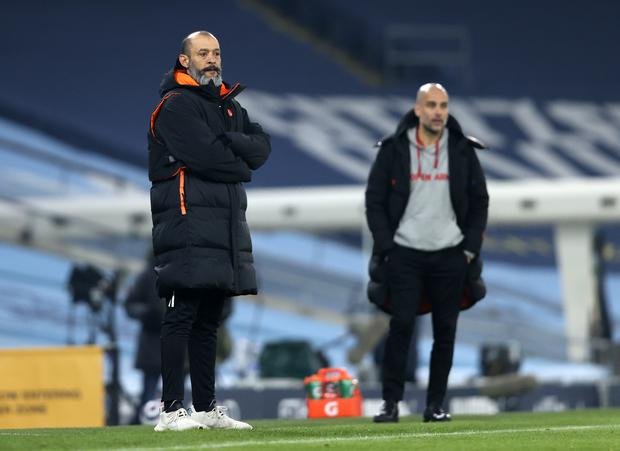 Pep Guardiola (right) feels City could learn much from their game against Wolves (Clive Brunskill/PA)