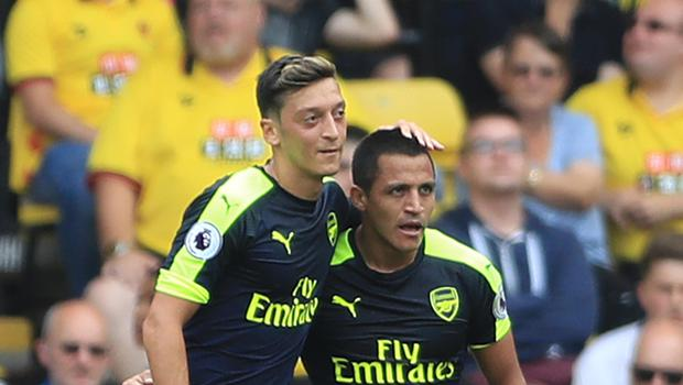 Alexis Sanchez, right, and Mesut Ozil, left, have just one year remaining on their contracts at Arsenal