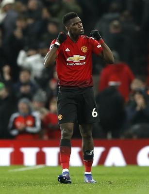 Paul Pogba and Manchester United lie in wait for both Liverpool and City in the run-in (Martin Rickett/PA)