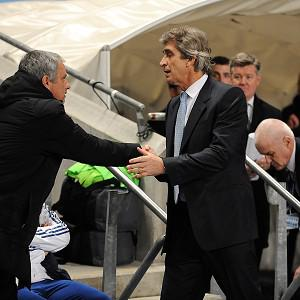 "Manchester City's manager Manuel Pellegrini, right, does not agree with Chelsea manager Jose Mourinho, left, that the Blues are a ""small horse"""