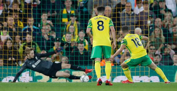Liverpool's Caoimhin Kelleher saves a penalty from Norwich City's Christos Tzolis