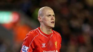 Liverpool's Martin Skrtel has signed a new contract with the club