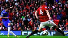 MANCHESTER, ENGLAND - MAY 05:  Juan Mata of Chelsea scores the winning goal during the Barclays Premier League match between Manchester United and Chelsea at Old Trafford on May 5, 2013 in Manchester, England.  (Photo by Alex Livesey/Getty Images)