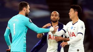 Hugo Lloris, left, and Son Heung-min make up after clashing at half-time (Adam Davy/NMC Pool/PA)