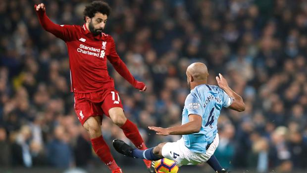 Vincent Kompany only received a yellow card for a late tackle on Mohamed Salah (Martin Rickett/PA)