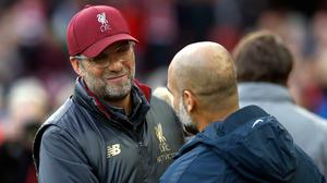 Jurgen Klopp, left, has expressed his sympathy for Pep Guardiola (Martin Rickett/PA)