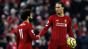 Liverpool's Virgil Van Dijk, right, and Mohamed Salah are title-bound (Peter Byrne/PA)