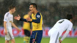 Chile forward Alexis Sanchez, pictured, remains confident Arsenal can improve their form