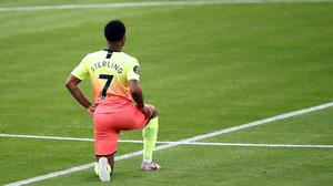 Manchester City's Raheem Sterling takes a knee in support of the Black Lives Matter movement (Julian Finney/NMC Pool/PA)