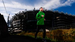 Ireland midfielder Jack Byrne passes Croke Park during a training run along the Royal Canal at Ballybough near his home in Dublin. (Photo: Stephen McCarthy/Sportsfile)
