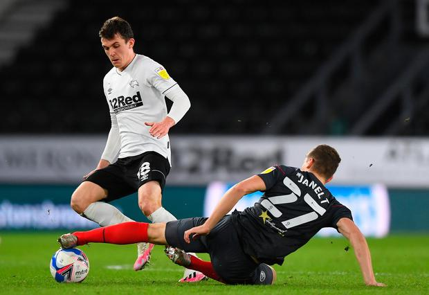 Jason Knight of Derby County is challenged by Vitaly Janelt of Brentford. Photo: Getty