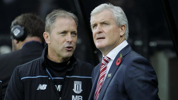 Mark Bowen, left, and Mark Hughes are plotting victory at Anfield