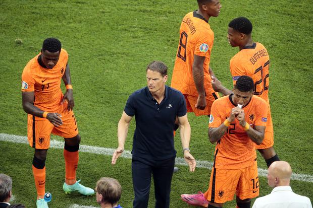 Holland boss Frank De Boer (centre) did not discuss his future after the loss (PA)