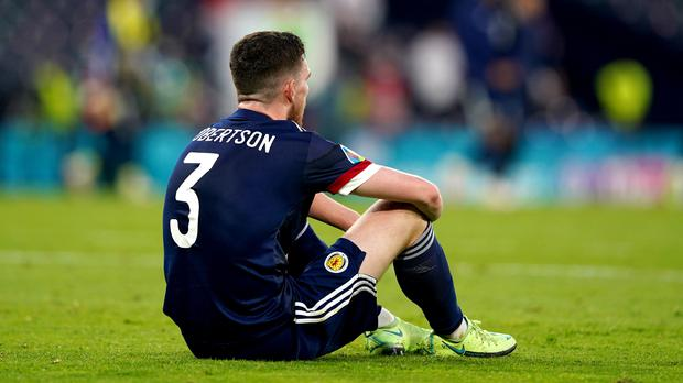 Scotland's Andrew Robertson looks dejected after his side crashed out of Euro 2020 (Andrew Milligan/PA)