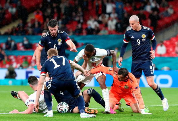 England and Scotland players battle for the ball in the Scottish penalty area in the latter stages of last night's stalemate at Wembley. Photo: PA Wire