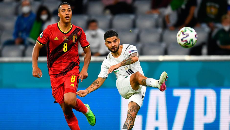Lorenzo Insigne of Italy scores while under pressure from Youri Tielemans of Belgium during the Euro 2020 quarter-final in Munich. Photo: Claudio Villa/Getty Images