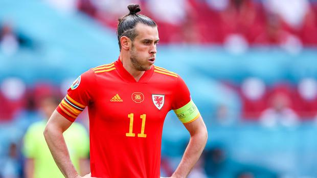 Gareth Bale says he will not quit Wales as long as he is playing football (PA)