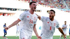 Spain's Aymeric Laporte celebrates scoring his side's second goal with Koke. Photo: Marcelo Del Pozo/Reuters