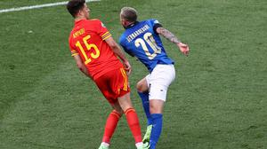 Italy's Federico Bernardeschi is fouled by Ethan Ampadu in a tackle which saw the Welsh player shown a red card