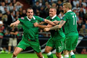John O'Shea, left, celebrates after scoring his side's equalizing goal with team-mates Jonathan Walters, centre, and James McClean