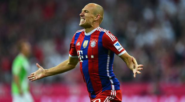 Arjen Robben of Bayern Muenchen celebrates scoring the second goal during the Bundesliga match between FC Bayern Muenchen and VfL Wolfsburg